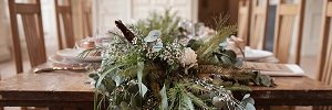 wedding table with foliage and flwoers runner