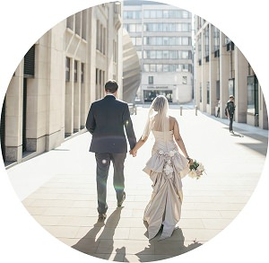 Bride and grrom walking down a London street on wedding day