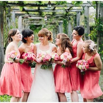 Great Fosters Wedding bride with bridesmaids in coral dresses