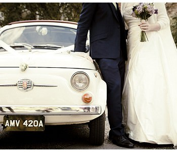 bride and groom by vintage fiat 500