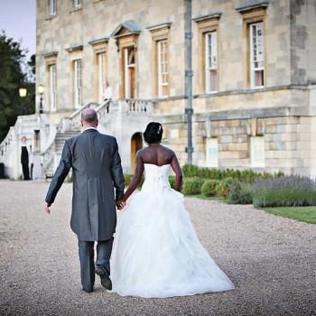 BRide and groom walk up to wedding venue