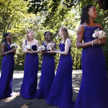 bridesmaids in royal blue dresses waiting to go into church