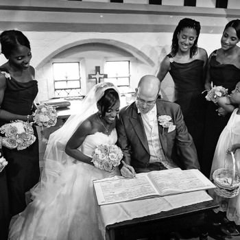 bride and groom sign the register