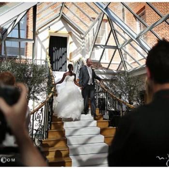 bride and groom enter wedding reception