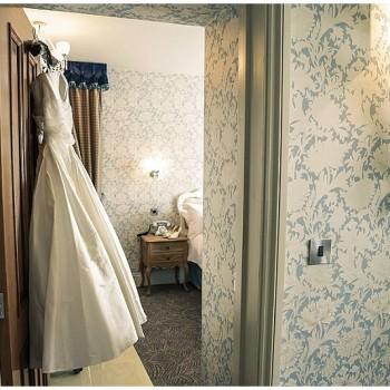 wedding dress hanging on door