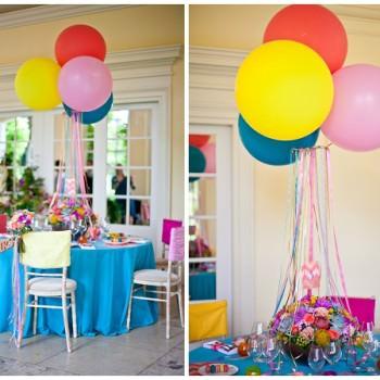 colourful geronimo balloons as table decor