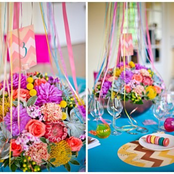 vibrant floral table centre with hanging ribbons