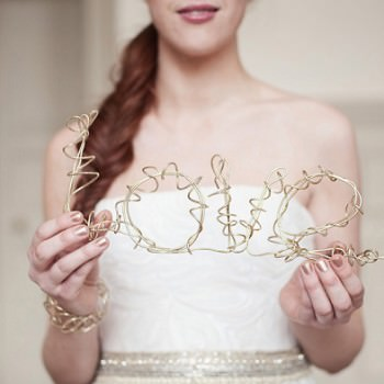bride holding love sign