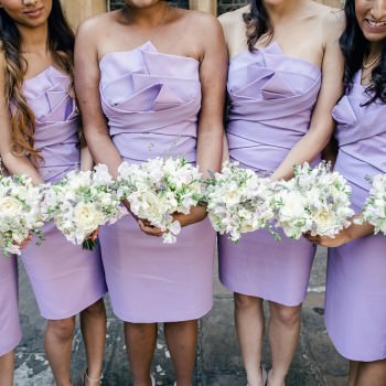 wedding bridesmaids in lilac with summer pastels bouquets