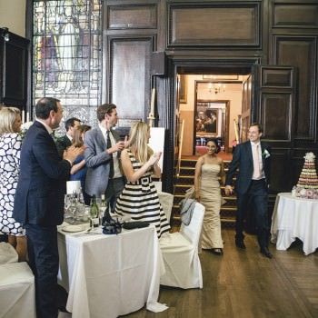 Bride and groom enter wedding reception at Stationers Hall