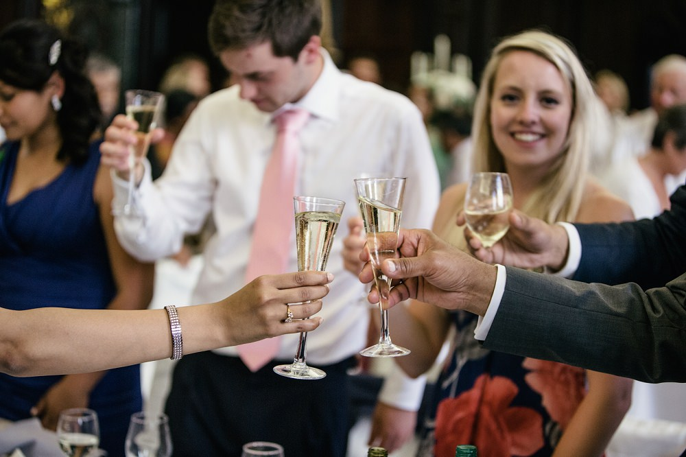 guests congratulate with champagne toast at wedding