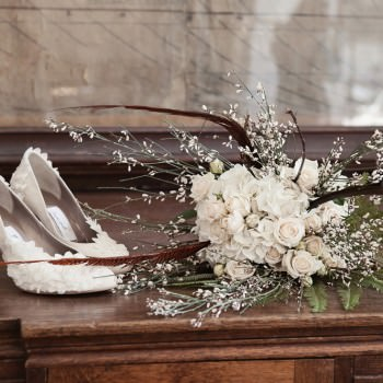 marsha hall bespoke wedding shoes and natural white roses and fern feathers bouquet
