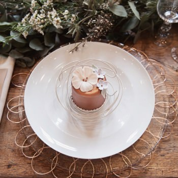 table setting with bronxe min wedding cake glass charger
