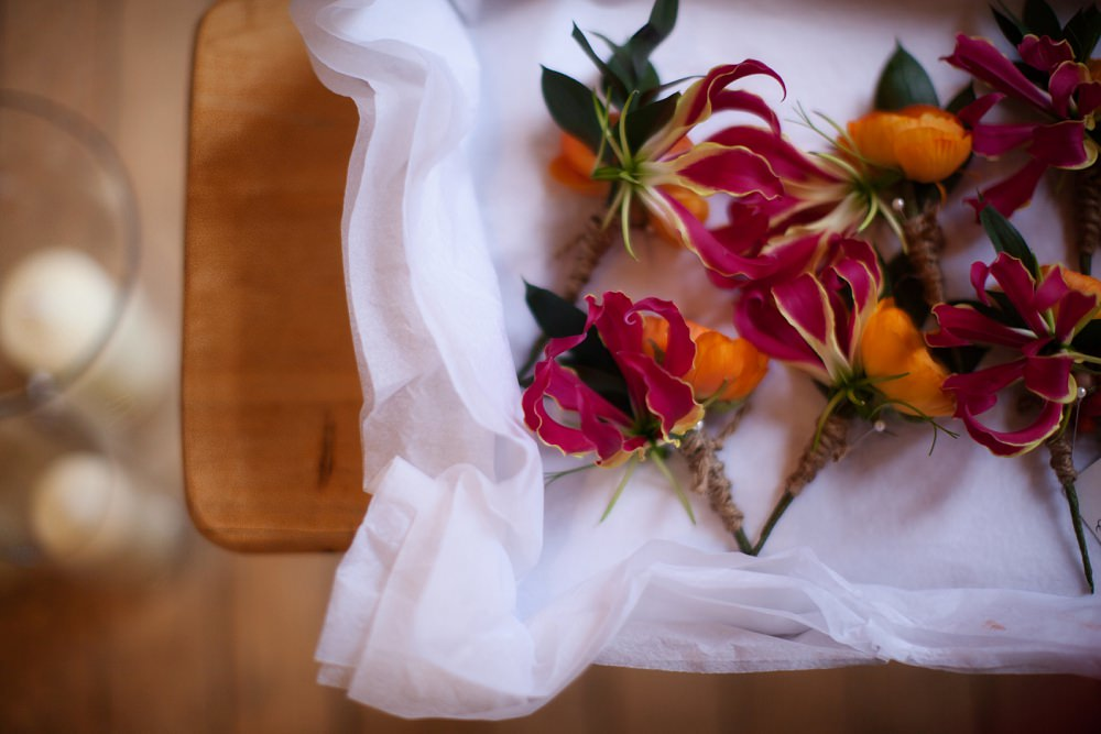 gloriosa lily buttonholes