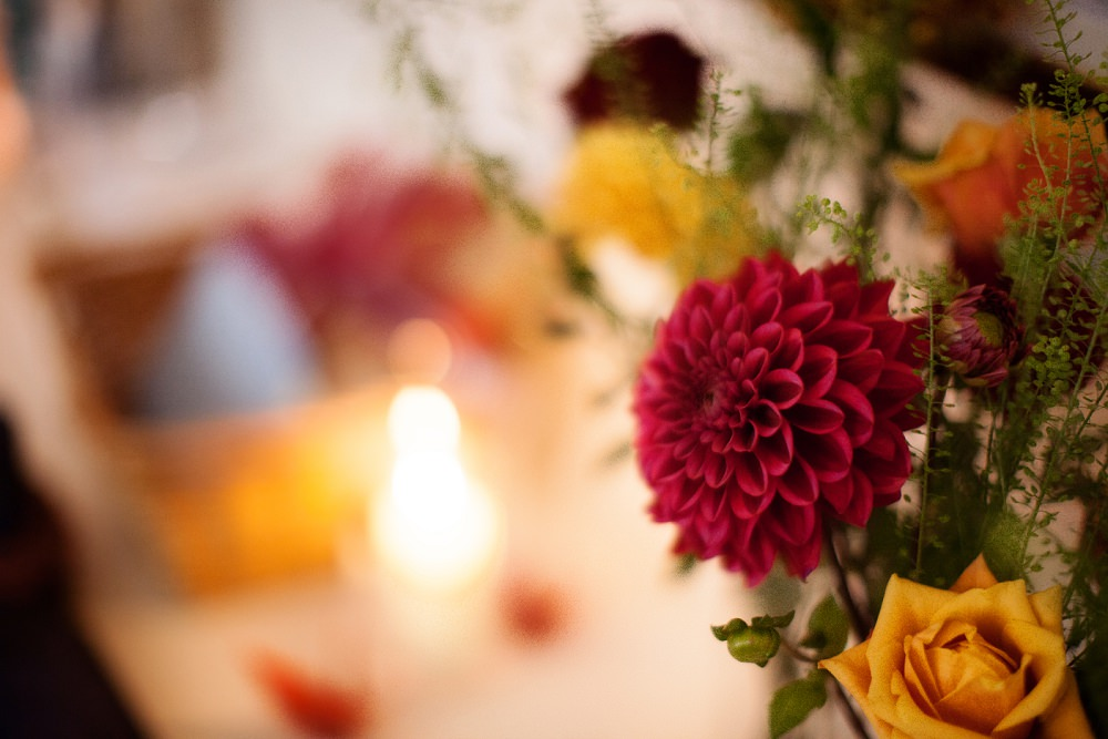 wedding flowers red dahlias and candle light