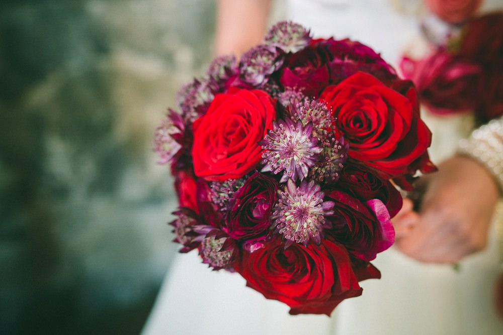red and purple hand tied wedding bouquet