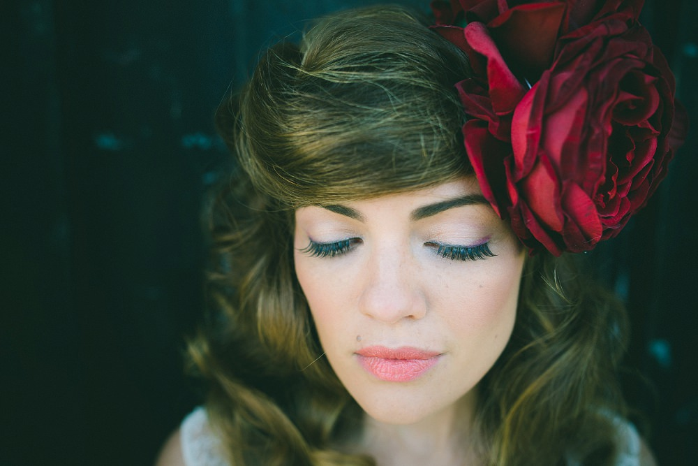 bride with red flower in hair