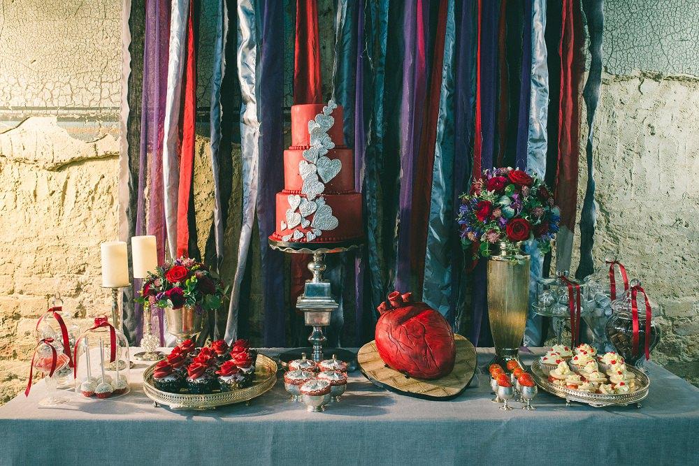 red heart themed wedding dessert table