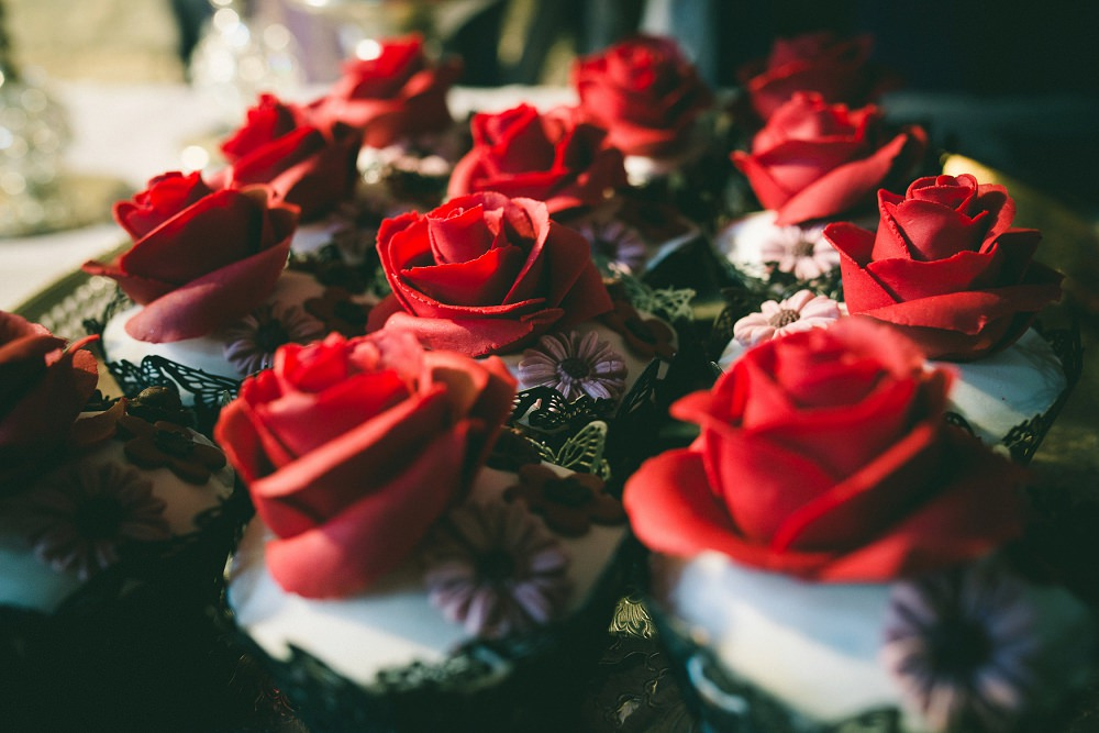 red rose topped choclate cupcakes