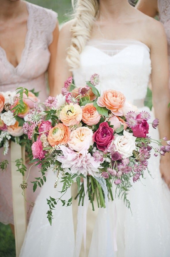 pastel peach and pink bouquet with ranunculus peonie and dahlia by Munster Rose photo by Melissa Oholendt Photography