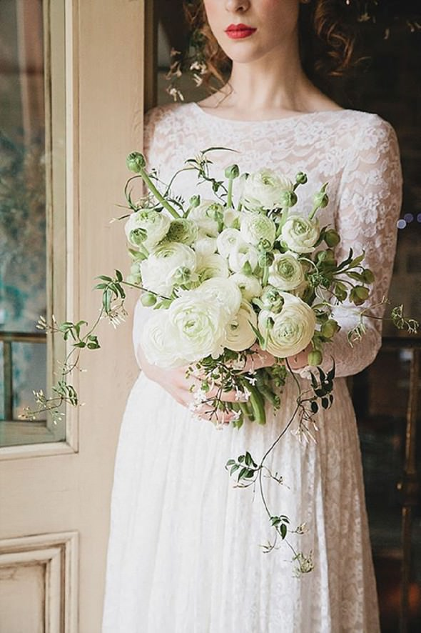 stunning all white ranunculus bouquet by Eve Photography