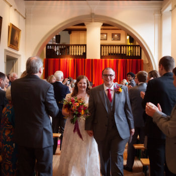 bride and groom walk down the aisle london wedding
