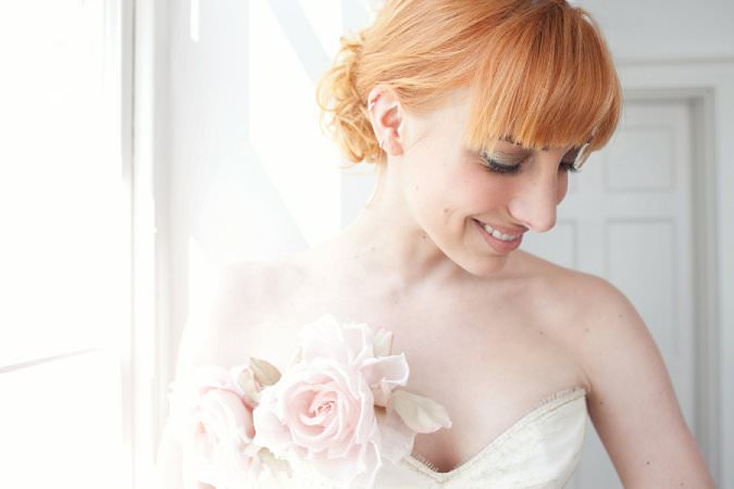 red haired bride with silk flowers