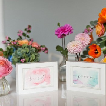 bride and groom watercolour framed placecards colourful flowers