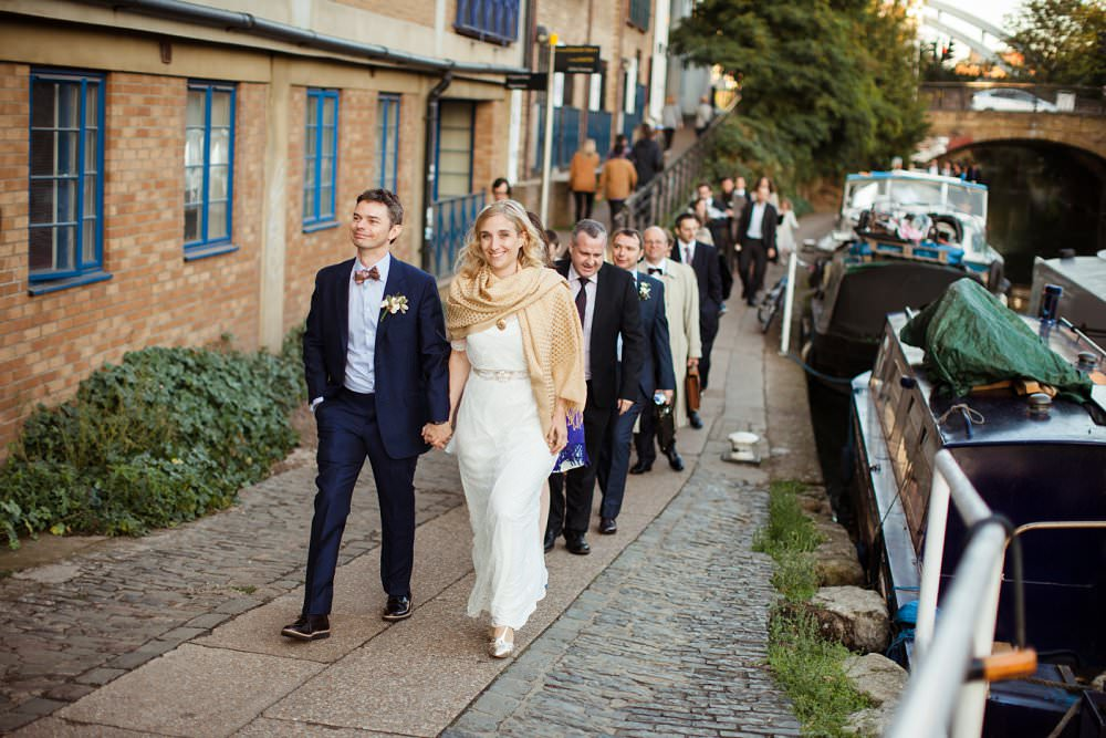bride and groom leads guests along canal to wedding party | London Wedding The Curries Photogrpahy | Always Andri Wedding Planning