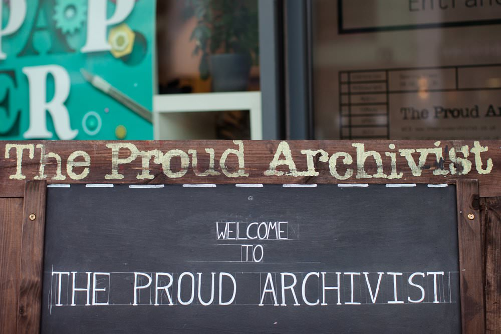 The Proud Archivist signage at wedding party | London Wedding The Curries Photogrpahy | Always Andri Wedding Planning