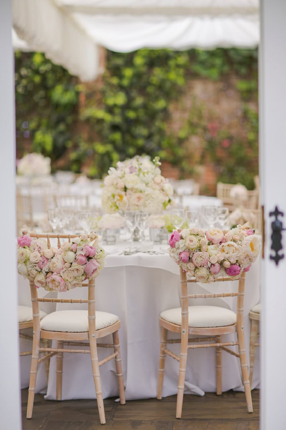 top-table-bride-groom-chairs-floral-garland