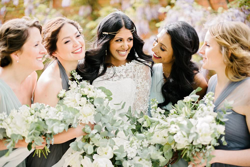 Happy bride with bridesmaids in grey dresses| guide to bridesmaids duties| Dominique Bader Photography