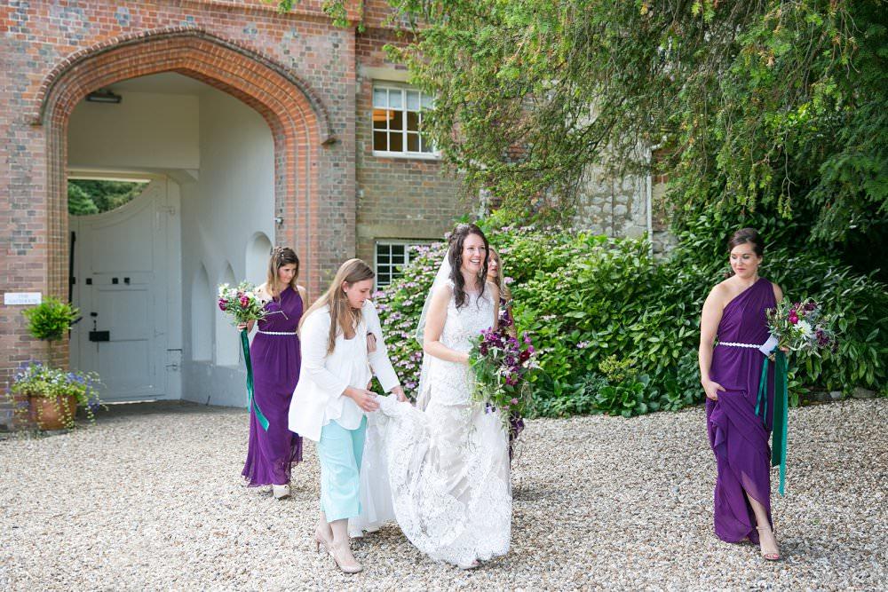 bride walking to ceremony with bridesmaids