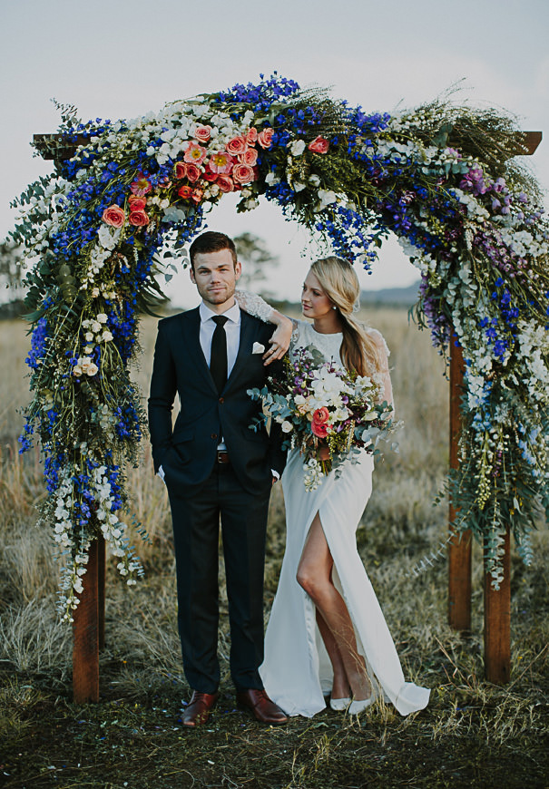 stunning blue and coral flower wedding ceremony arch