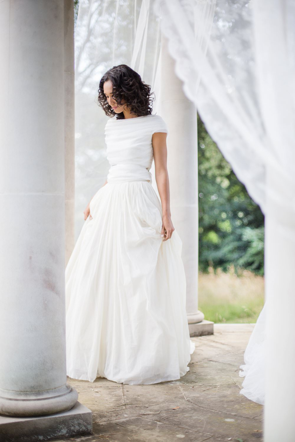 Bride wears silk Cortana Wedding dress from Morgan Davies Bridal
