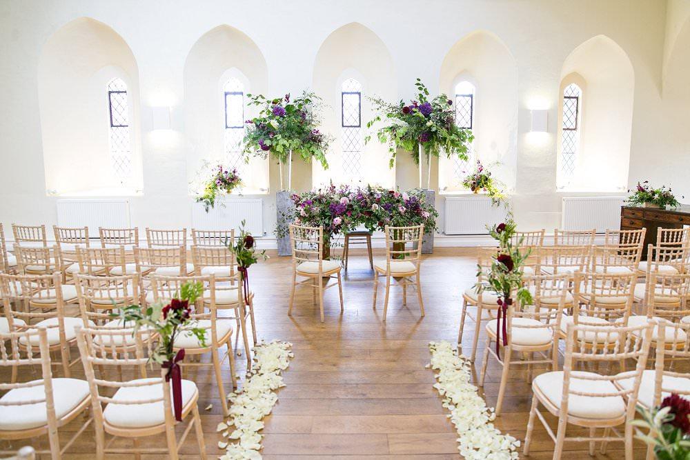 wedding ceremony set up at Farnham Castle Surrey Flowers by Jay Archer Photography by Anneli Marinovich