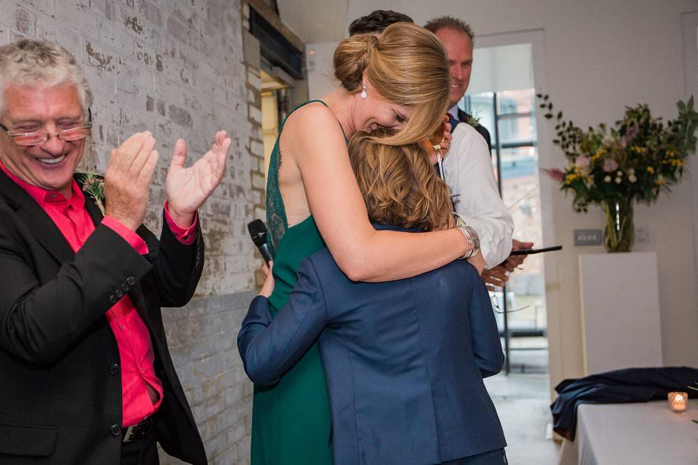 brife hugs daughter at wedding
