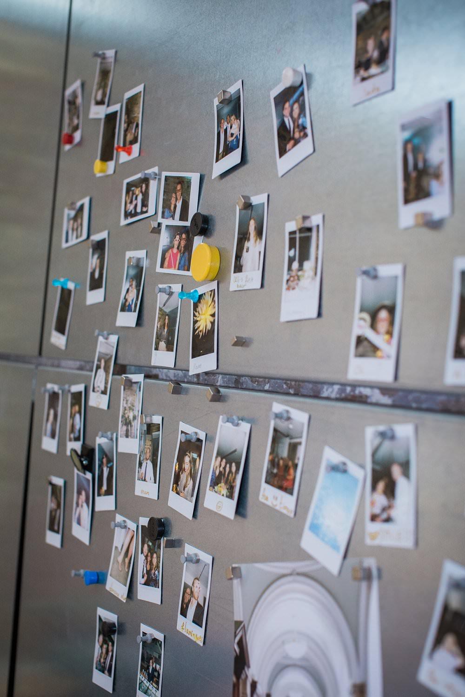 polaroids on magnetic wall wedding photobooth