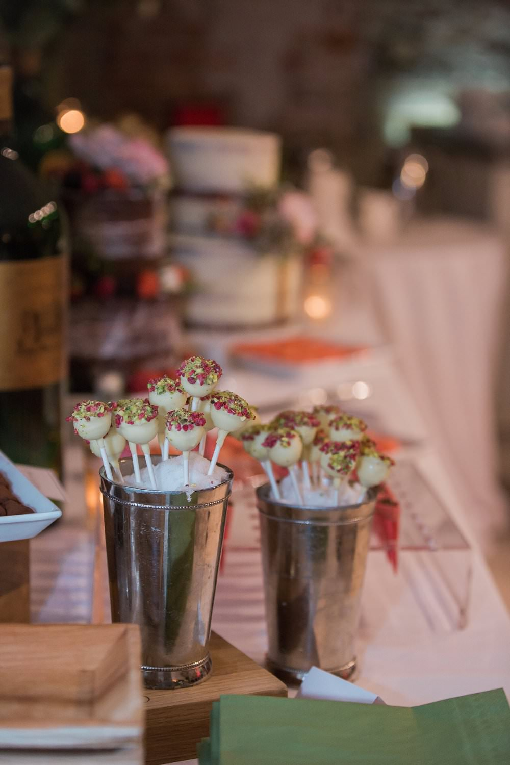 cake pops on dessert buffet with wedding cakes