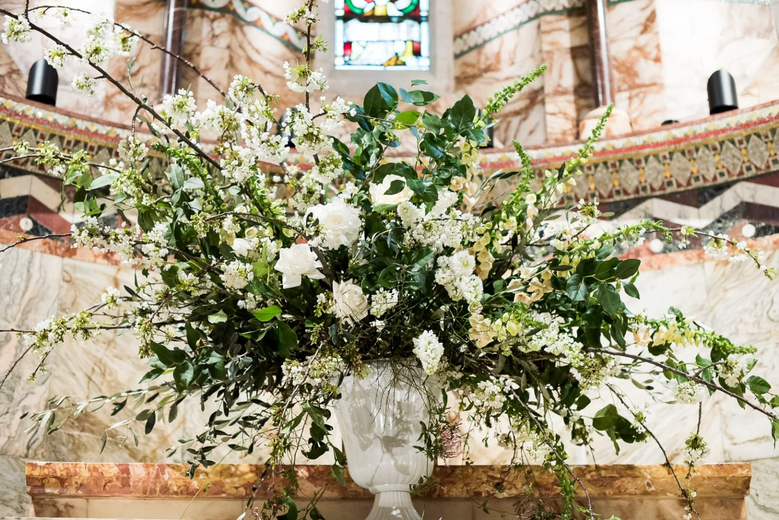 large floral display withcherry blossom, white roses, anenomes and folaige Fitzrovia Chapel wedding photoshoot but Always Andri Wedding Design