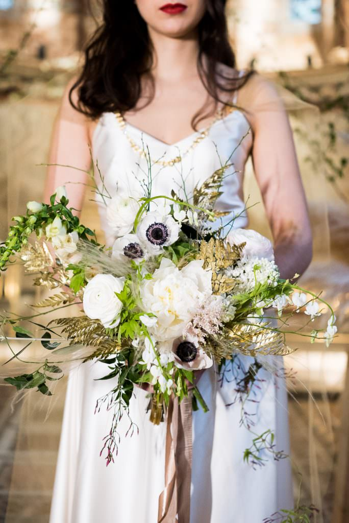 white flowers with gold touches and foliag wedding bouque Fitzrovia Chapel wedding photoshoot but Always Andri Wedding Design