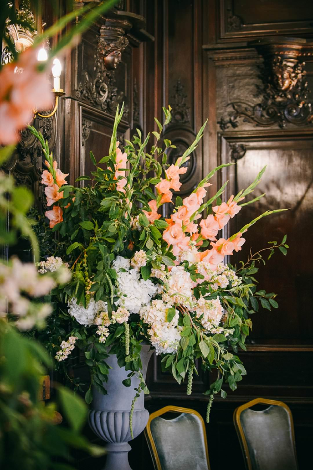 wedding flowers in peach and white at Dartmouth House London Wedding Venue
