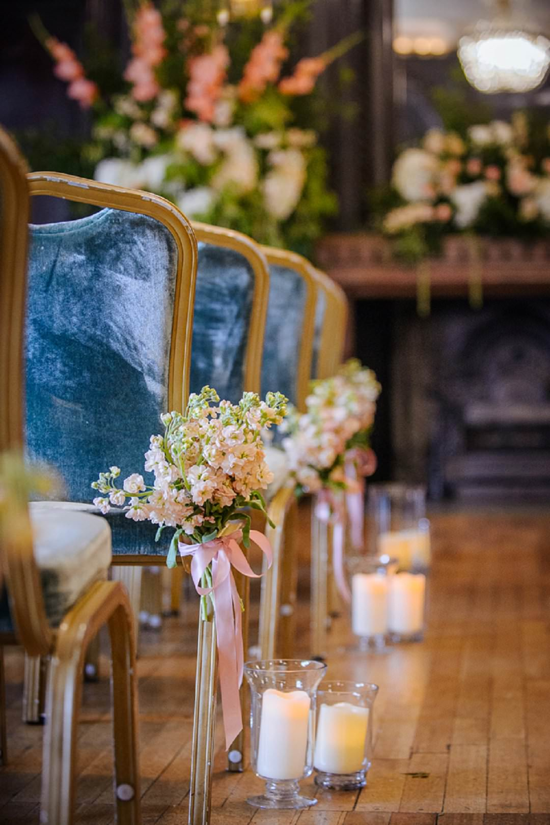 candles and peach stock for ceremony aisle Dartmouth House London Wedding Venue