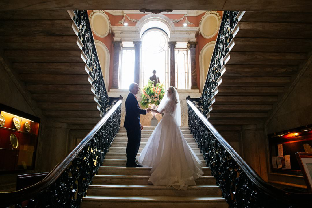 father and bride walk up stairs Dartmouth House London Wedding Venue