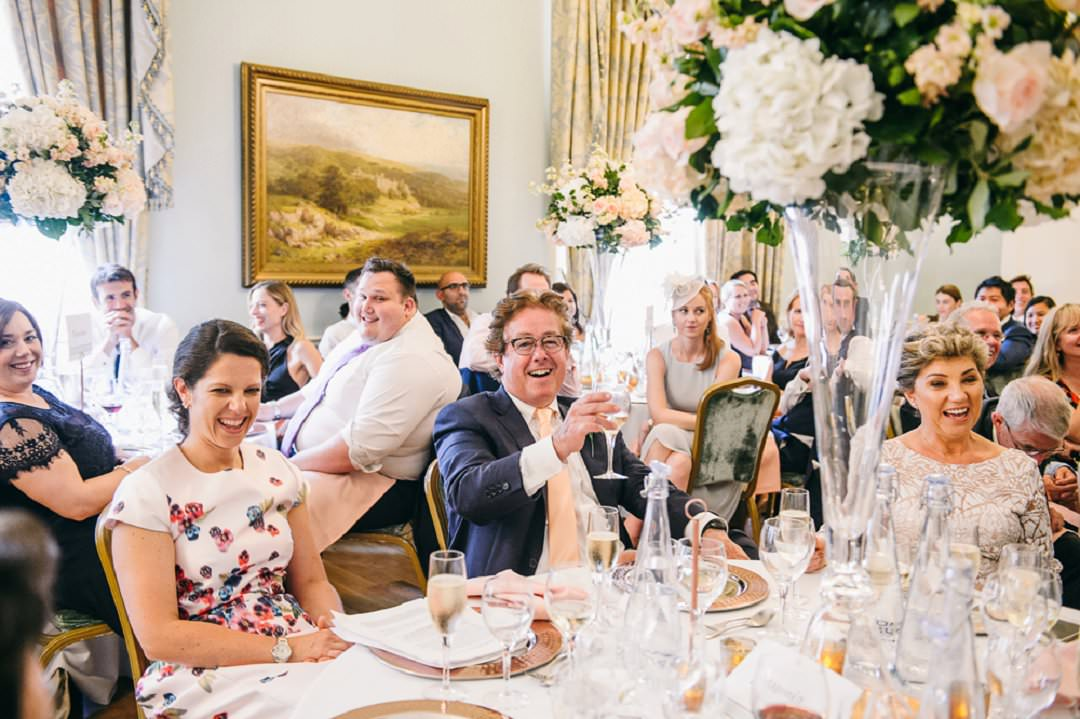 guests enjoy speeches at Dartmouth House London Wedding Venue