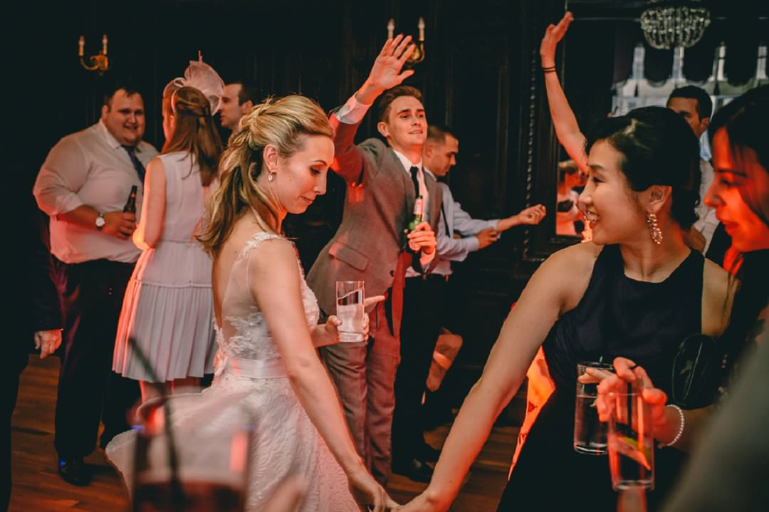 bride dancing with friends at Dartmouth House London Wedding