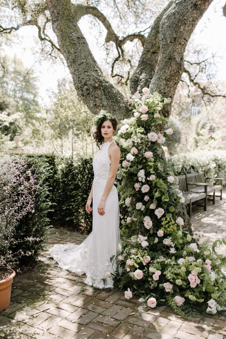 ramblimg roses on tree with bride Always Andri Wedding Planner + Designer Beccy Goddard Photography Chelsea Physic Garden Photoshoot