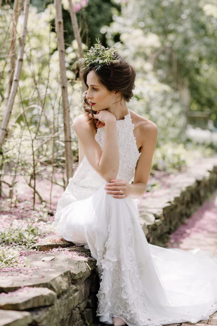 bride sitting on wall in garden Always Andri Wedding Planner + Designer Beccy Goddard Photography Chelsea Physic Garden Photoshoot
