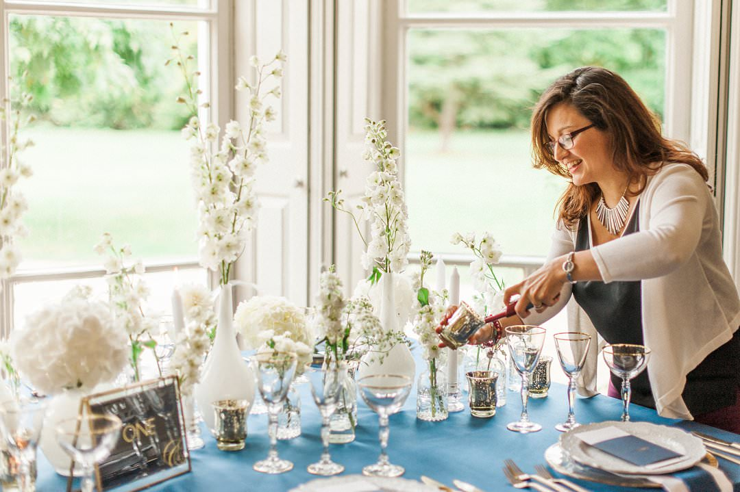 wedding designer lighting candle at table