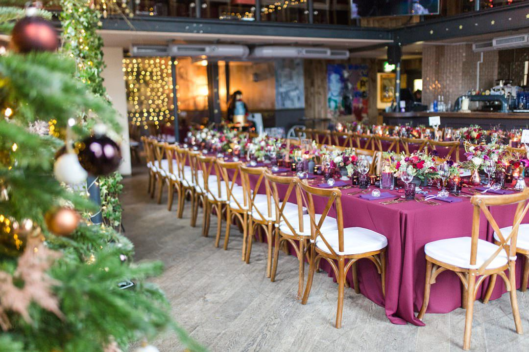 winter wedding longtable with burgundy linen and christmas tableware